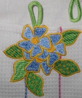 машинная вышивка петельки на полотенце деталь