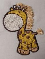 машинная вышивка жираф в технике фриндж